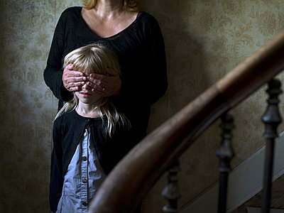 Mother and daughter in staircase - p945m1161607 by aurelia frey