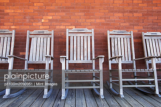 Row of Rocking Chairs - p1100m2090951 by Mint Images