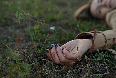 Woman on grass - p1363m2122487 by Valery Skurydin