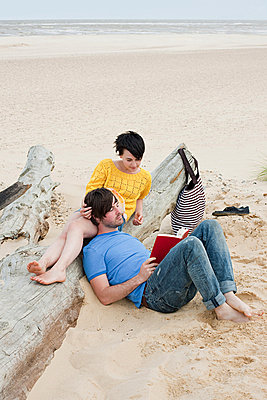 Young couple at the beach - p9247095f by Image Source