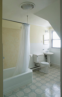 Small traditional bathroom with linoleum flooring - p5551946f by Darren Setlow