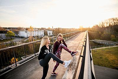Two women stretching, Lake Phönixsee, Dortmund - p890m2231042 by Mielek