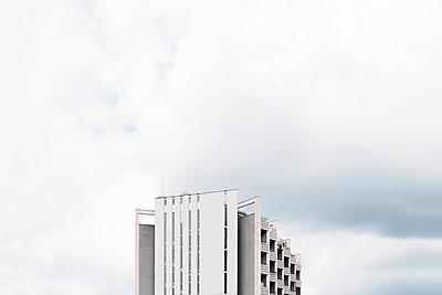 High rise against clouds - p1340m1465822 by Christoph Lodewick