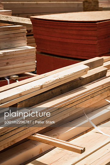 Stacks of wood planks and plywood at lumberyard - p301m2296787 by Peter Stark