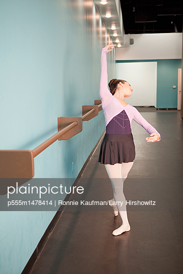 Caucasian ballet dancer training in studio