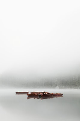 Boats in fog on Lake Braies - p1383m1496365 by Wolfgang Steiner
