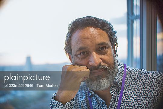 Portrait confident businessman at window - p1023m2212646 by Tom Merton