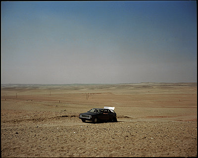 Two men in a car, Egypt - p1028m2002100 by Jean Marmeisse
