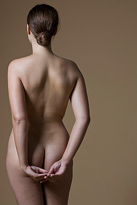 Rear view of a nude woman standing - p30115494f by Lena Clara