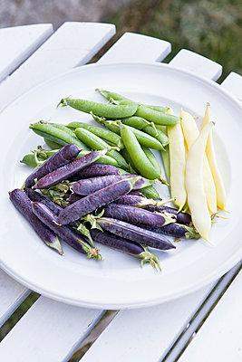 Fresh peas on plate - p312m1121489f by Lina Karna Kippel