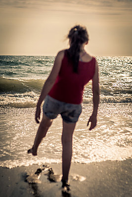 Girl by the sea - p1402m1487151 by Jerome Paressant