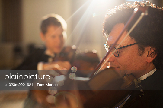 Violinists performing - p1023m2201621 by Tom Merton
