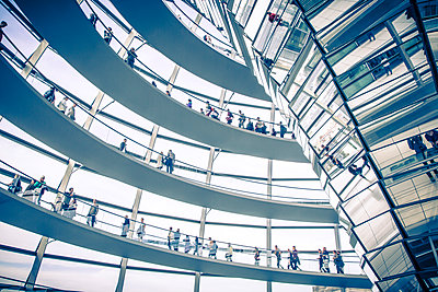 Interior shot of the Reichstag, German parliament building with visitors, Berlin, Germany - p1062m1172146 by Viviana Falcomer