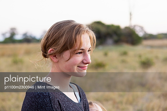 Portrait of teenage girl on safari, Okavango Delta, Botswana. - p1100m2300946 by Mint Images