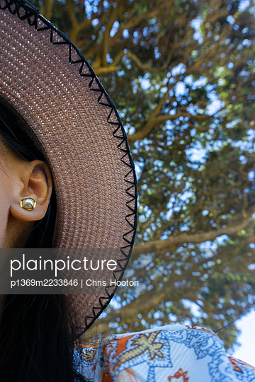 Woman with hat and earring - p1369m2233846 by Chris Hooton