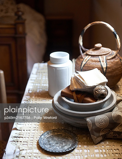 Paper and string in grey bowls with teapot in Sicilian kitchen - p349m2167758 by Polly Wreford