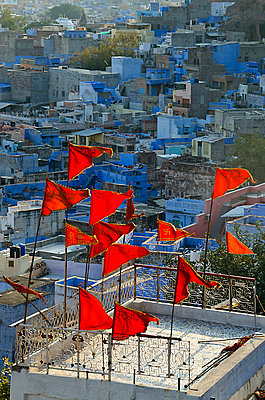 Red Flags flying above Blue City - p1072m941387 by chinch gryniewicz