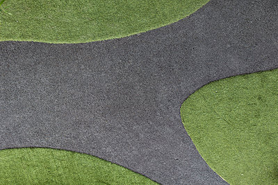 Minimalist garden design and park with artificial turf and asphalt - p728m2099868 by Peter Nitsch