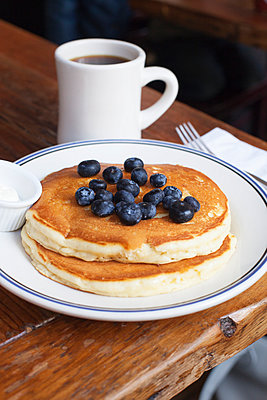 Blueberry pancakes and coffee - p956m892200 by Anna Quinn