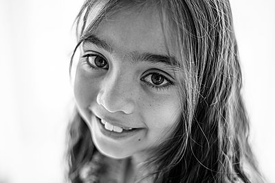 Close up black & white portrait of multi racial young girl - p1166m2212851 by Cavan Images