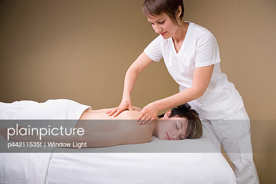 A Woman Getting A Massage From A Massage Therapist