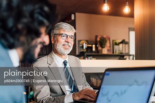 Italy, Businessmen using laptops in creative studio - p924m2300745 by Eugenio Marongiu