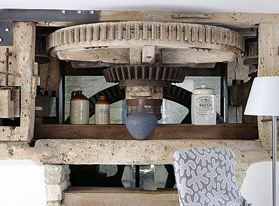 Old mechanism for grinding flour in renovated Cotswolds mill house - p349m790361 by Brent Darby