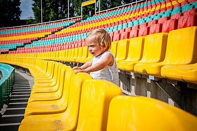 Toddler girl in a stand, Friedrich-Ludwig-Jahn-Sportpark - p1093m2193598 by Sven Hagolani