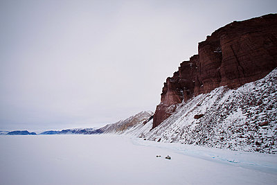 Red cliffs in snowy landscape - p924m757098f by Justin Lewis