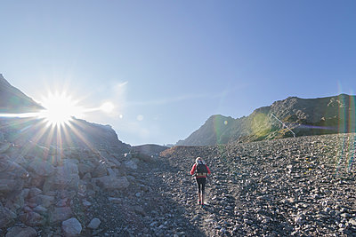 View of senior woman hiking, Valais, Switzerland - p1166m2202305 by Suzanne Stroeer