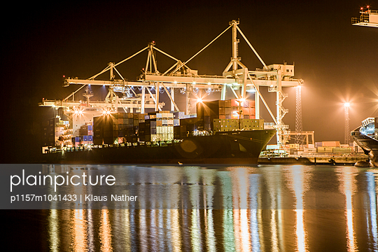 Container harbor at night - p1157m1041433 by Klaus Nather