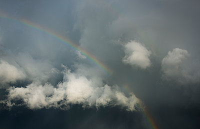 A rainbow visible against dark clouds, Honfleur, Normandy, France - p429m2217824 by Mischa Keijser