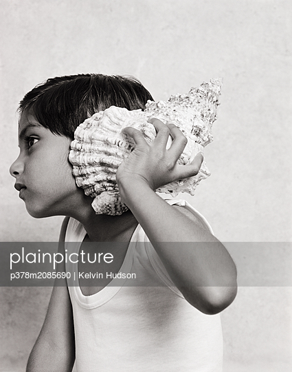 Boy and shell - p378m2085690 by Kelvin Hudson