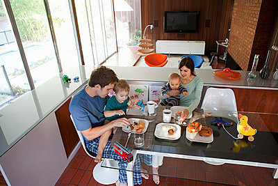 Family eating breakfast - p9242683f by Image Source