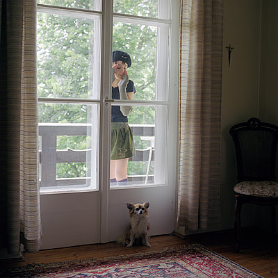 Young girl and small dog - p1610m2185275 by myriam tirler