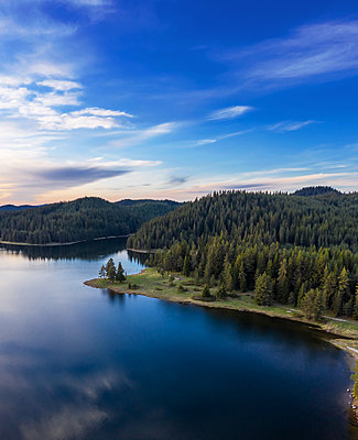 View of drone over the mountain lake at sunset - p1596m2184498 by Nikola Spasov