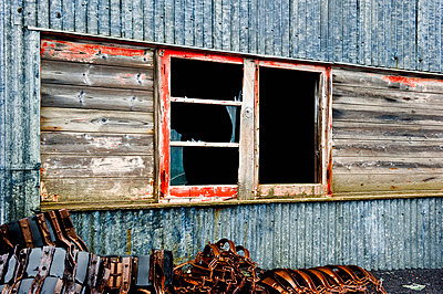 Broken windows on the side of a weathered wooden building; antarctica - p442m719181f by Jim Julien