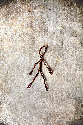 Man Figure Made of Wire on Grungy Surface  - p1248m2216082 by miguel sobreira