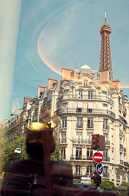 Reflection in cafe window of Paris apartments and Eiffel Tower - p1072m829304 by Neville Mountford-Hoare