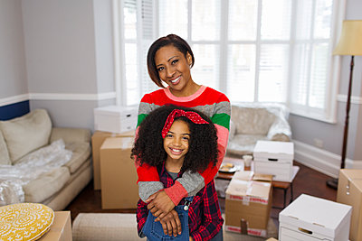 Portrait happy mother and daughter moving house - p1023m2087941 by Sam Edwards