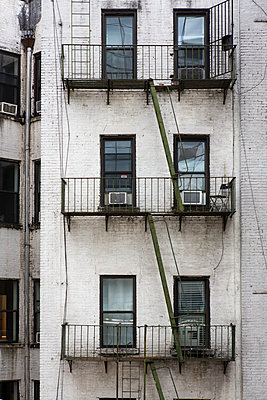 House with fire escape ladders  - p1057m1466861 by Stephen Shepherd