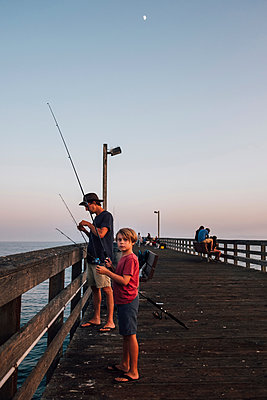 Father and son on pier fishing, Goleta, California, United States, North America - p429m1504789 by JFCreatives