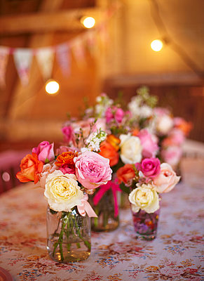 Cut flowers and lit lights in late summer  UK - p349m2167852 by Sussie Bell