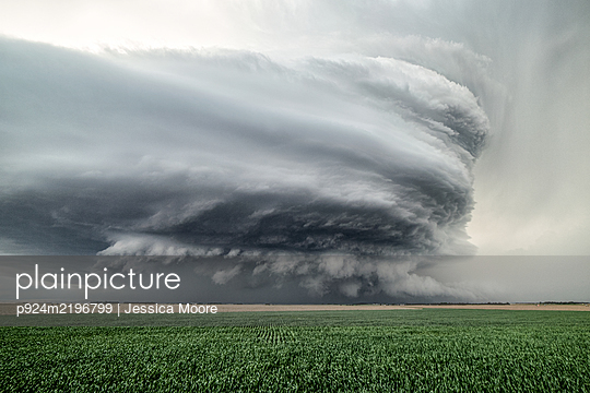 Sculpted super-cell, a mesocyclone weather formation thunderstorm clouds, drifting majestically across the Nebraska sand hills. - p924m2196799 by Jessica Moore