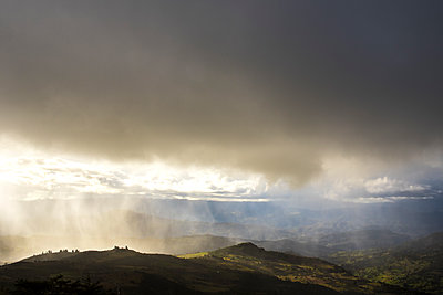 Sun shower over Mongui - p1369m2164474 by Chris Hooton