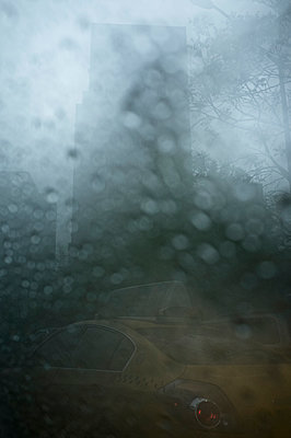 Taxi viewed through rainy window - p301m960768f by Michael Mann