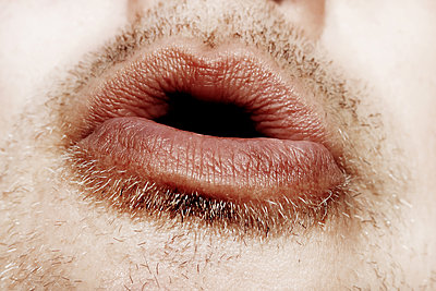 Close-up of man's mouth blowing - p450m1502859 by Hanka Steidle