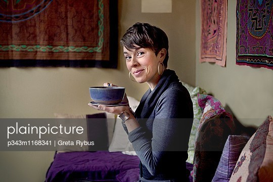 Woman enjoying with cup of tea - p343m1168341 by Greta Rybus