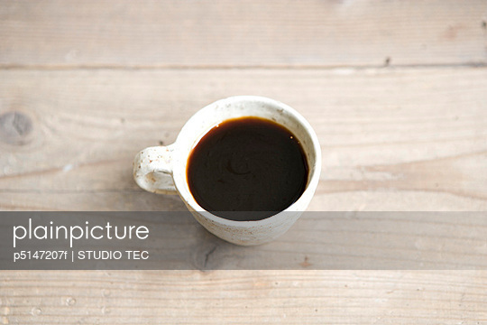 A Cup of Coffee on a Wooden Surface