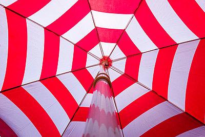Red and white parasol - p1418m2196371 by Jan Håkan Dahlström